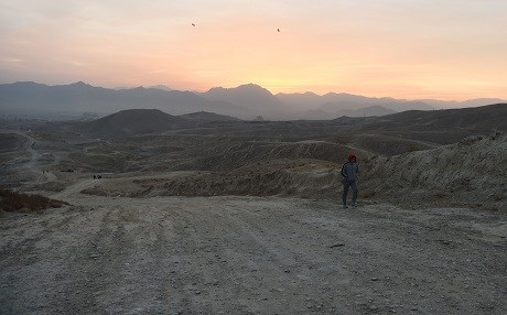 An Afghan man hikes on a hill on the outskirts of Kabul on November 9, 2018. Photo: Wakil Kohsar | AFP