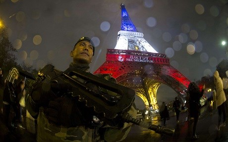 The Eiffel tower lit up with the French tricolour and motto of Paris - fluctuat nec mergitur – 'meaning she is tossed by the waves but doesn't sink,' in tribute to victims of the November 13, 2015 terror attacks. File photo: Joel Saget/AFP/Getty Images