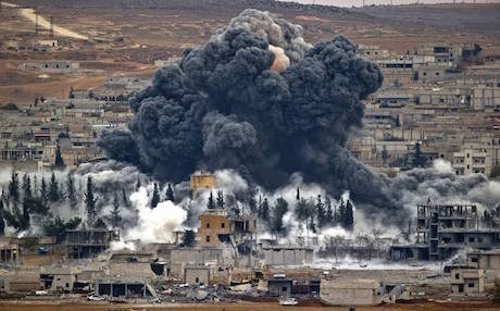 Smoke rises from the Kurdish city of Kobane following an American airstrike against ISIS positions in November. Photo: AP.