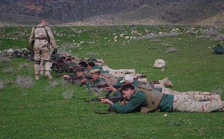 Dutch soldier leads Peshmerga in  rifle practice. Photo by author