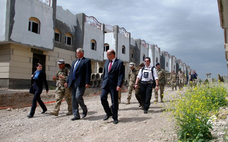 German State Secretary of Defense Markus Grübel tours an urban warfare training exercise conducted by foreign advisers for Peshmerga Saturday, April 11. Photo by Campbell MacDiarmid.