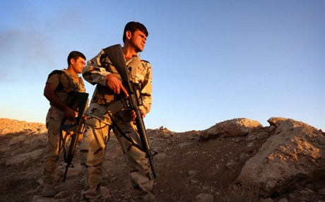 Kurdish Peshmerga fighters take position on the front line in Makhmur. AFP file photo