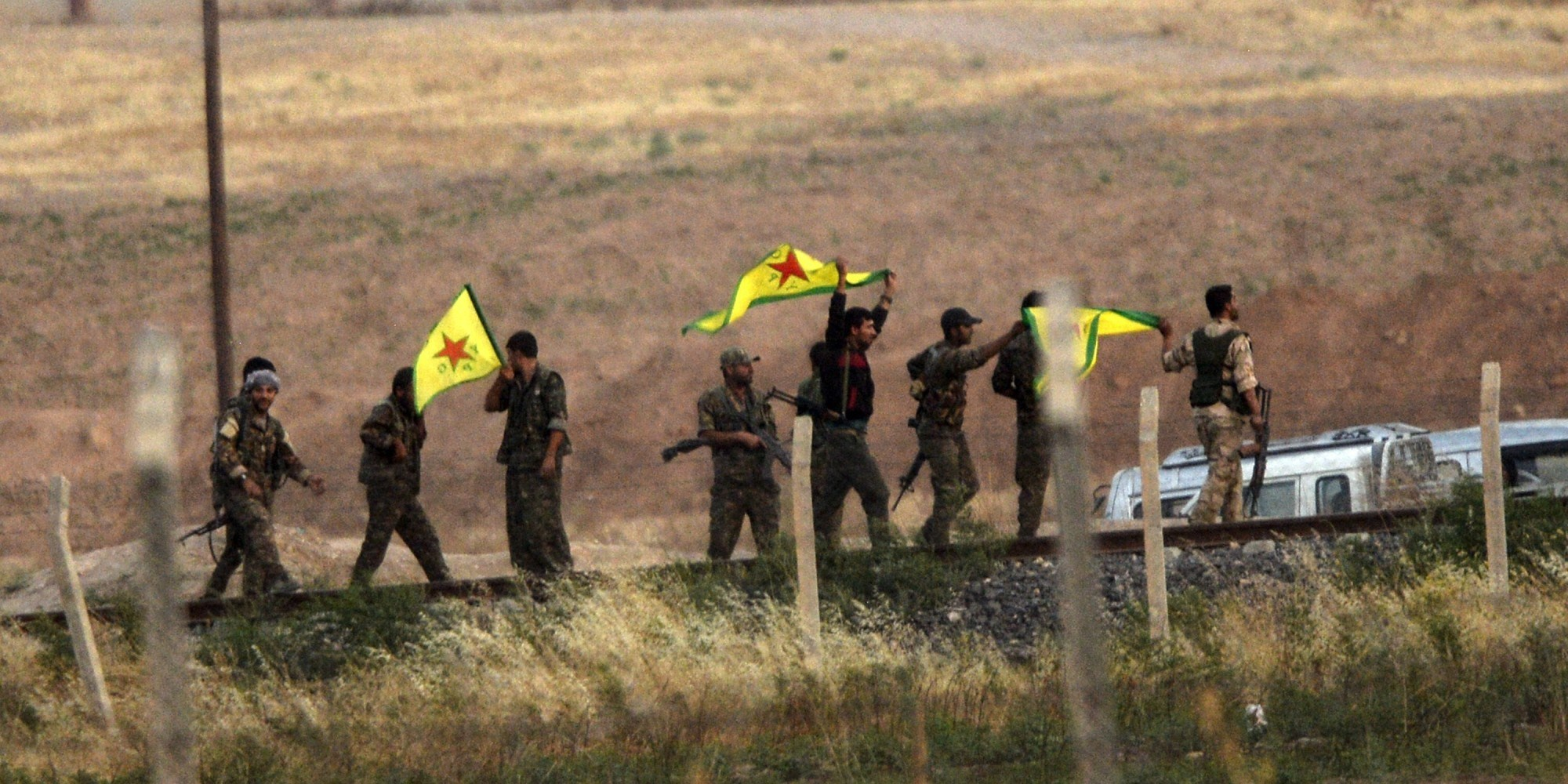 Kurdish People's Protection Units (YPG) fighters hold their organization near Tal abyad (Gire Sipi). photo: AP