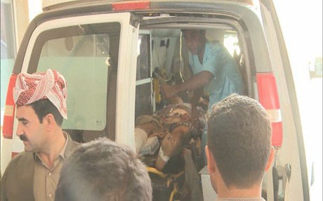 Injured civilians being carried to Duhok State Hospital. Photo : Rudaw