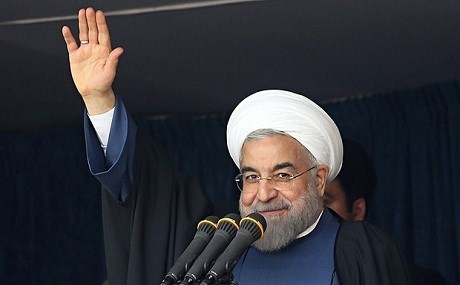 Hassan Rouhani waves to the crowd while giving a speech during a visit to Isfahan. Photo: AFP