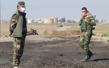 File photo of Kurdish soldiers surveying the site of a bomb attack on a road between Mosul, Iraq, and the Syrian border in northern Iraq.  Photo: Kurdistan Region Security Council.