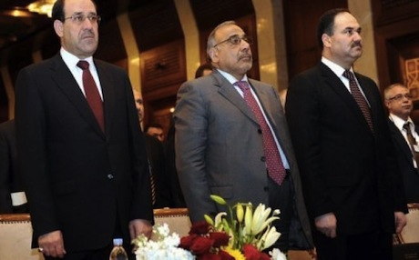 Iraqi Prime Minister Nuri al-Maliki (L) and members of his cabinet listen to the Iraqi national anthem. Photo: AFP
