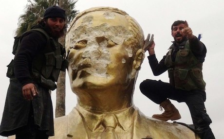 Islamist rebels trying to demolish a statue of former Syrian President Hafez al-Assad in Idlib. AFP file photo