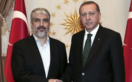 Turkey's President Recep Tayyip Erdogan, right, shakes hands with Hamas leader Khaled Mashal, left. AP file photo.