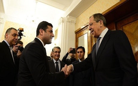 Demirtas (left) is greeted by the Russian foreign minister. Photo: AA.