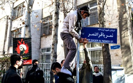 Angry protesters installing a street sign named after Saudi Shiite cleric Sheikh Nimr al-Nimr. Photo: MEHR