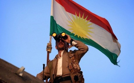 A Kurdish Peshmerga fighter holds a position on the front line in the Gwer district, south of Erbil. AFP Photo.