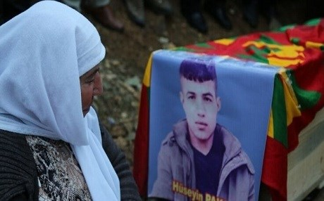 A mourner at Huseyin Paksoy's coffin.