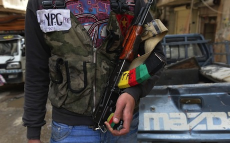 A fighter from the People's Defense Units (YPG) in Aleppo, Syria. April 2013. Photo: AFP