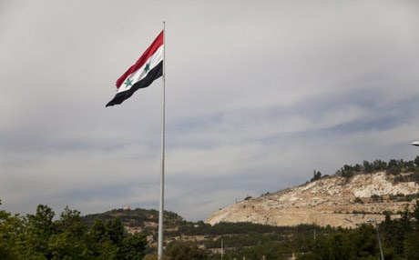 Syrian flag flying over Damascus, the capital of Syria. Photo: AP