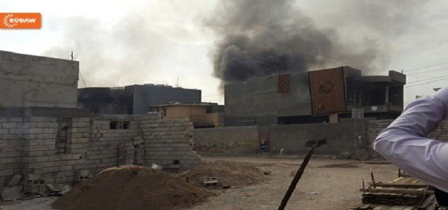 A column of smoke rises at the site of a military clash inside Khurmatu.