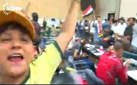 Protesters take over the Iraqi parliament in this screen grab from a Rudaw video.