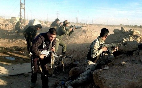 Iraqi Security Forces engage ISIS militants in Ramadi last December. AP photo.