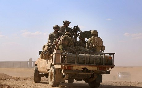 U.S. Special Operations forces ride in the back of a pickup truck in the village of Fatisah in the northern Syrian province of Raqqa on May 25. (Delil Souleiman/AFP/Getty Images)
