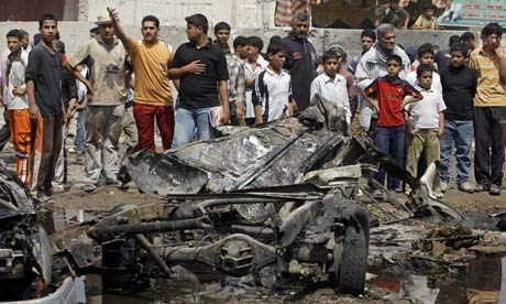 A crowd gathers at the site of a car bomb attack in the Sadr City neighborhood of Baghdad. AP file photo
