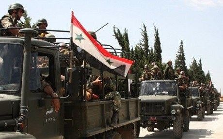 The Syrian Army, depleted from draft dodgers and deserters, is increasingly reliant on pro-regime militias. Photo: AP