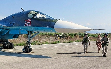 Russian pilots check their Su-34 bomber in Hmeymim airbase, Latakia, Syria before a flight. Photo: EPA