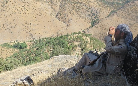 A KDPI fighter watches Iranian shelling of the border with the Kurdistan Region. Photo: KDPI.