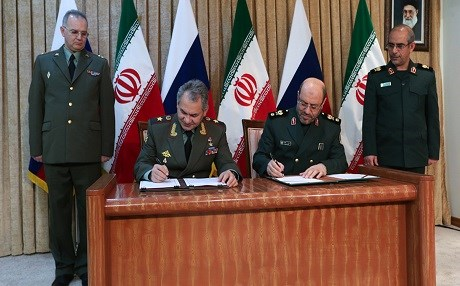 Russia's Defense Minister Sergei Shoigu and his Iranian counterpart Hossein Dehghan signed an agreement to expand military ties in Tehran Iran. Jan. 2015.  Photo: Russian Defense Ministry