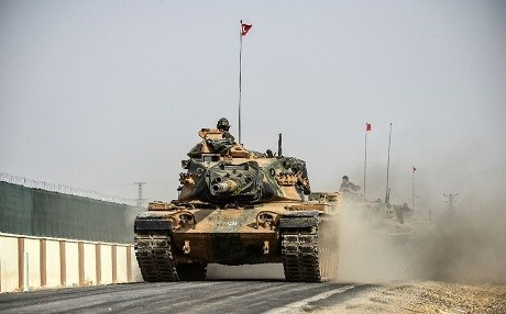 A Turkish army tank drives towards the northern Syrian town of Jarablus on Thursday. Photo: Bulet Kilic/AFP