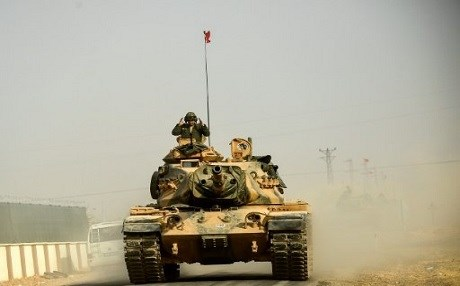 A Turkish army tank drives into Jarablus on Thursday. Photo: AFP