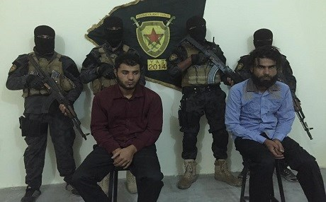 Two members of the Sultan Murad brigade, captured by YPG counter-terror unit, confessed to torturing YPG members seized near Jarablus. Photo: Redur Xelil Twitter/YPG