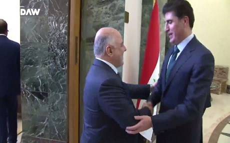 Kurdish Prime Minister Nechirvan Barzani (right) meets his Iraqi counterpart Haider al-Abadi in Baghdad last week, where the two agreed on a key oil deal.