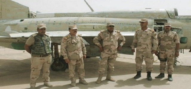 Iraqi commanders pose next to a derelict MiG-21 at the Qayyara airbase after its recapture in July. Photo: Iraqi Ministry of Defence.