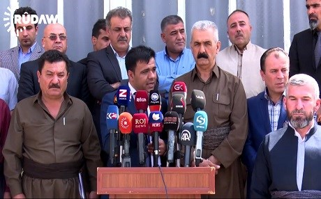 Kurdish factions addressing reporters in Kirkuk.
