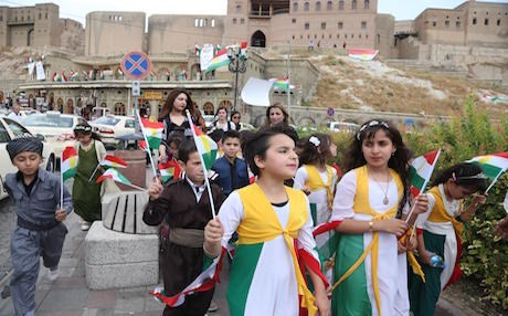 School children walk through the streets of downtown Erbil to support a call for a referendum on Kurdish independence.