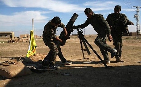 Syrian Democratic Forces (SDF) troops firing a mortar. Getty Images.