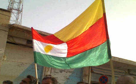 Kurdistan and PYD flags sown together and waved on the streets of Kobane on the day of its liberation from Syrian forces in July 2012. Photo: dimoqrati.info