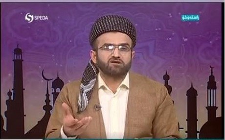 Dr. Wushyar Ismail presents a religious programe on Speda TV on Tuesday, the official satellite channel of the moderate Kurdistan Islamic Union. Photo:screenshot