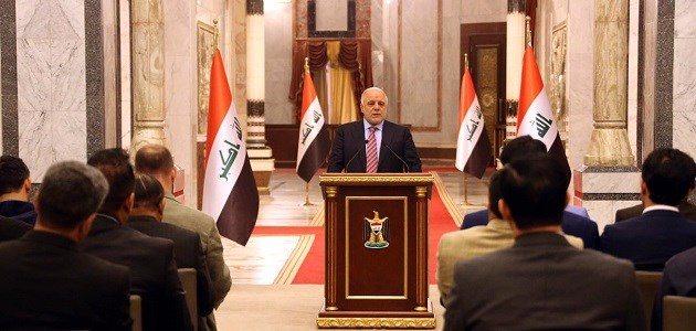 Prime Minister Haider al-Abadi talks to reporters on Tuesday. Photo: Iraqi PM office.