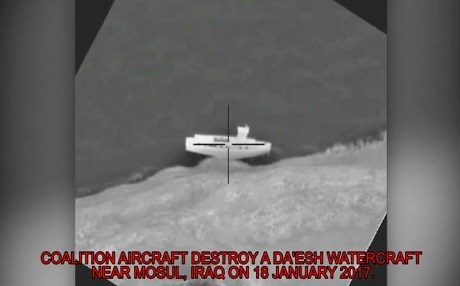 Image from a coalition airstrike of an ISIS barge on January 18. Photo: CJTF video