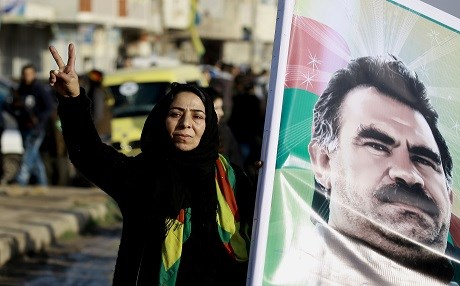 A Syrian Kurdish women holds a portrait of jailed Kurdish leader Abdullah Ocalan during a rally in Qamishli last Monday denoucing that Kursdish reprensantatives were not invited to take part in the upcoming Astana peace talk to be held on Monday. Photo: AFP