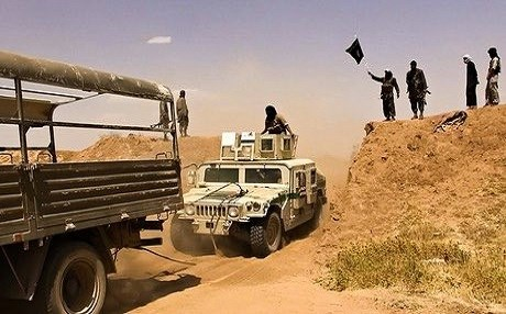 An iconic picture that claims to show ISIS militants driving military vehicles through a newly-cut road on the Iraqi-Syrian border in summer 2014, paving the way to announce their self-styled Islamic State in both countries shortly after. This picture and similar ones, published by the extremist group, went viral in the aftermath of the fall of Mosul in June the same year. Photo: AFP