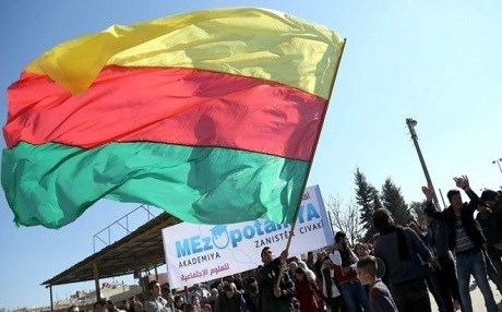 The official flag of the Kurdish region in Syria, also known as Rojava. The Kurdish authorities have established their own cantons, and have proposed a draft constitution late December, which notably dropped  the Rojava word from the official name of the region, instead  proposing a name which they claim will be more  inclusive. It calls itself the Democratic Federal System of Northern Syria. Photo: AFP