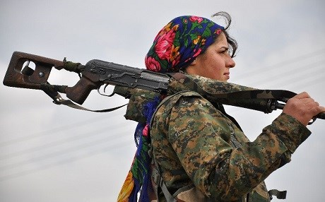 A fighter with the Kurdish Women's Protection Units (YPJ). Photo: Delil Souleiman/AFP