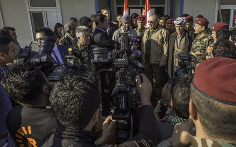 Harjit Sajjan, the Canadian Minister of Defence, with Peshmerga leaders gives an interview in 2015. Photo: Canada Armed Forces