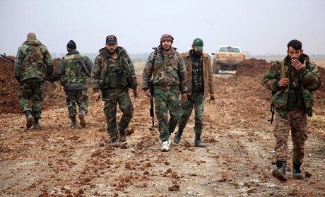 Pro-Syrian government forces walk in the northern province of Aleppo. Photo: AFP
