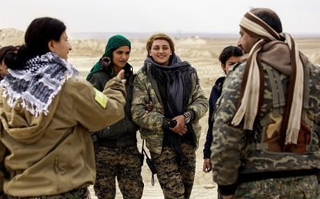 Female Arab fighters among the Syrian Democratic Forces, made up of US-backed Kurdish and Arab fighters, stand together near the village of al-Torshan, 20 km on the outskirts of Raqa last Monday. Photo: AFP/Delil Souleiman.