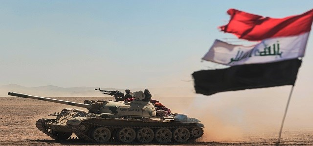 Tanks and armoured vehicles of the Iraqi forces, supported by the Hashed al-Shaabi  paramilitaries, advance towards the village of Sheikh Younis, south of Mosul on Sunday. Photo:AFP