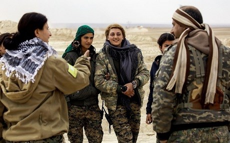 Cihan Sheikh Ahmad (L), spokesperson for the SDF's Wrath of Euphrates campaign to isolate Raqqa, speaks with fellow SDF fighters on the outskirts of Raqqa on February 6. Photo: Delil Souleiman/AFP