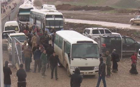 Buses carrying west Mosul IDPs arrive at Sewdinan camp in the Kurdistan Region. Photo: Rudaw video